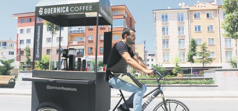 MAN OPENS COFFEE SHOP ON THREE WHEELS