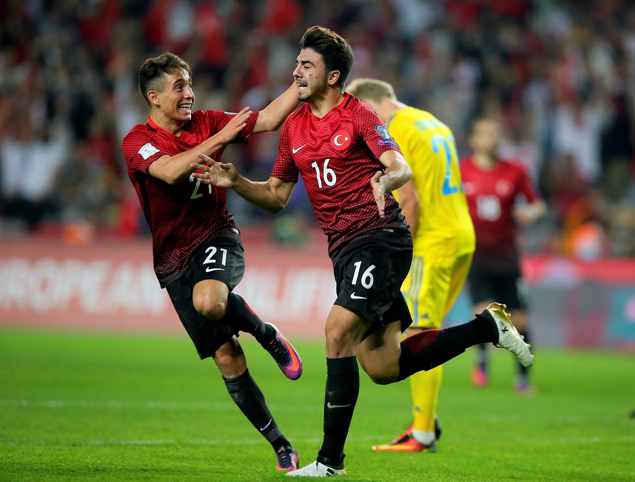 Turkey's Ozan Tufan, right, celebrates after scoring, as his teammate Emre Mor runs to join him, during the World Cup Group I qualifying match between Turkey and Ukraine. (AP Photo)