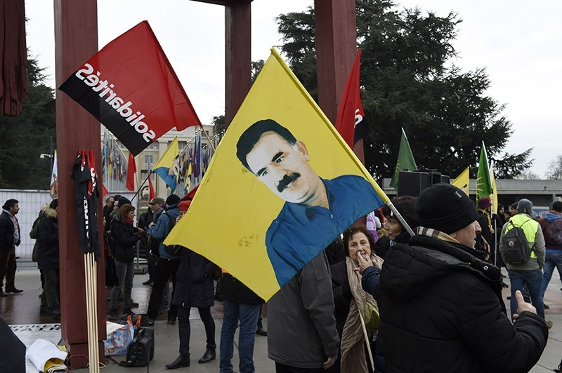 Pro-PKK demonstrators hold a flag with the image of jailed PKK leader Abdullah u00d6calan in a rally in front of the U.N. headquarter building in Geneva, Switzerland on Jan. 12, 2017. (AFP Photo)