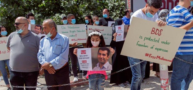 PALESTINIAN PROTESTERS URGE ISRAEL TO FREE BOYCOTT ACTIVIST