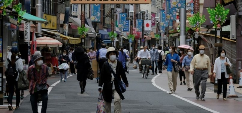 JAPANS COVID CRISIS REAWAKENS DEFLATION FEARS AS CASH HOARDING RETURNS