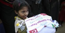 Turkish aid group gives food, digs wells for Rohingya