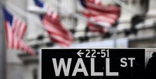Wall Street dips on weak earnings
