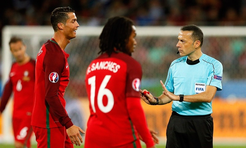Cristiano Ronaldo (L) of Portugal argues with Turkish referee Cuneyt Cakir (R) during the UEFA EURO 2016 group F preliminary round match between Portugal and Iceland at Stade Geoffroy Guichard in Saint-Etienne, France, 14 June 2016.  EPA Photo
