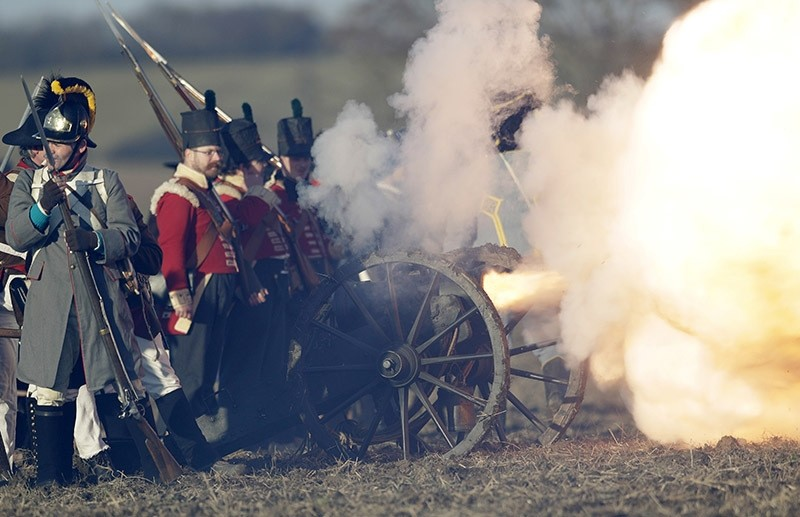 History enthusiasts dressed in regimental costumes fire a cannon as they take part in a re-enactment of Napoleon's famous battle of Austerlitz, celebrating its 211th anniversary near Slavkov u Brna, Czech Republic on Dec. 3, 2016. (AP Photo)
