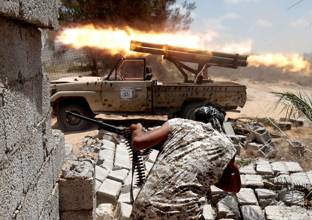 Libyan forces allied with the U.N.-backed government fire during a battle with DAESH militants in Sirte.
