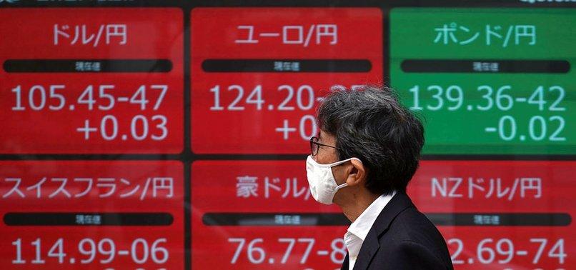 ASIAN STOCKS HIT RECORD PEAK AS VACCINE HOPES DAMPEN VIRUS FEARS