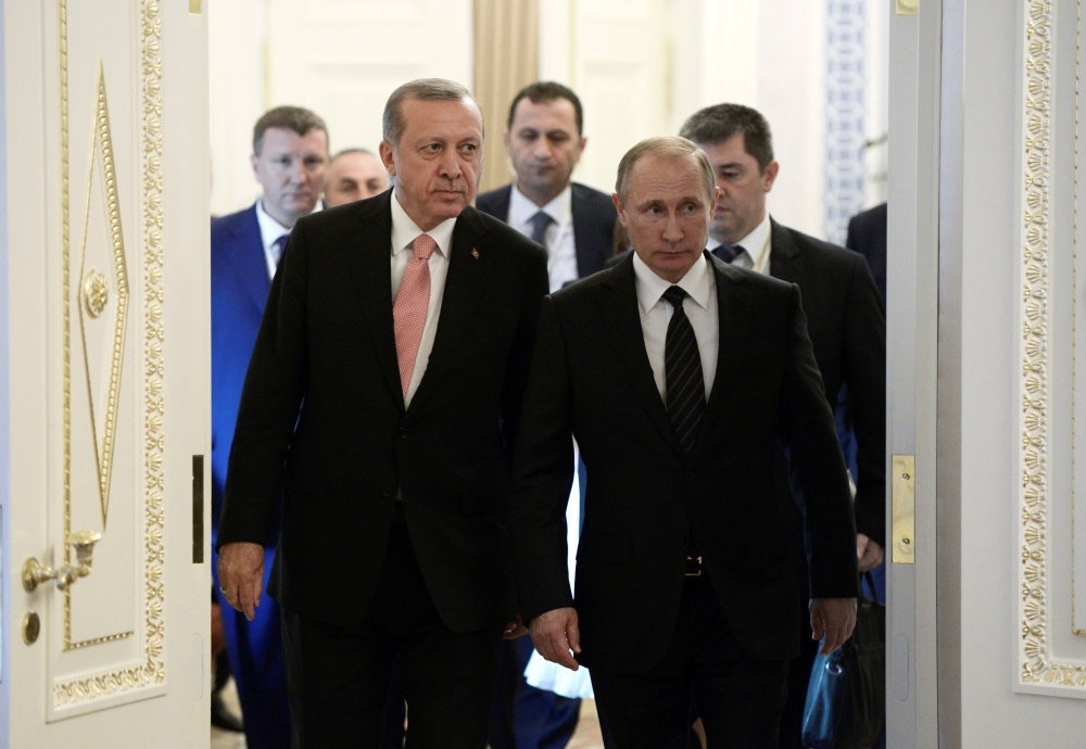 Turkish President Tayyip Erdou011fan (L) and Russian President Vladimir Putin attend a press conference following their meeting in St. Petersburg yesterday.