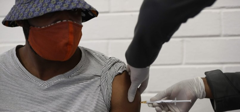 AFRICANS PIN HOPES ON VACCINE FOR NORMALCY