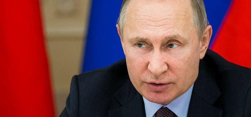 PUTIN SAYS UK NEEDS ANSWERS BEFORE FINDING FAULT