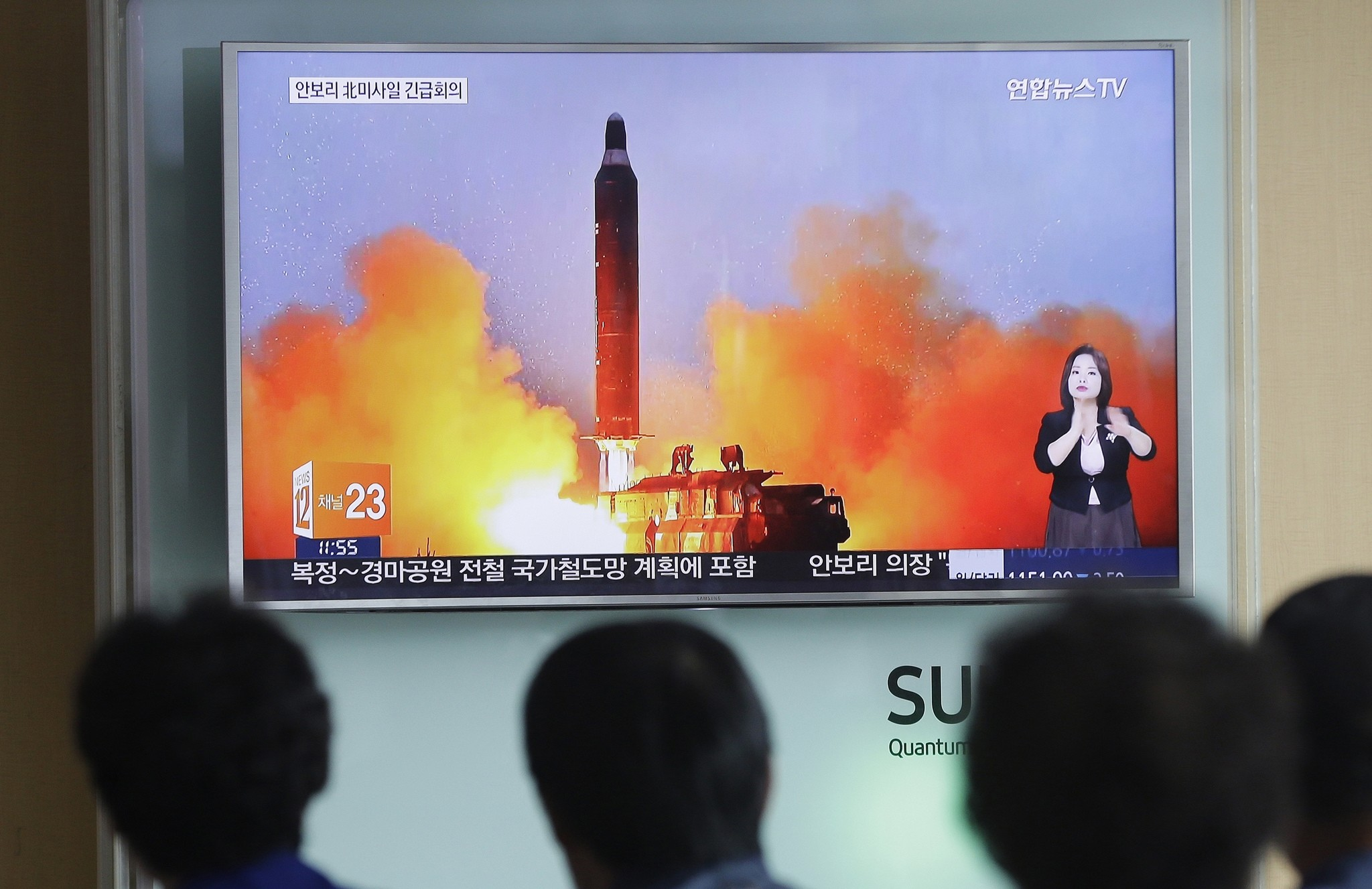 In this June 23, 2016, file photo, people watch a TV airing an image of North Korea's ballistic missile launch published in North Korea's Rodong Sinmun newspaper. (AP Photo)