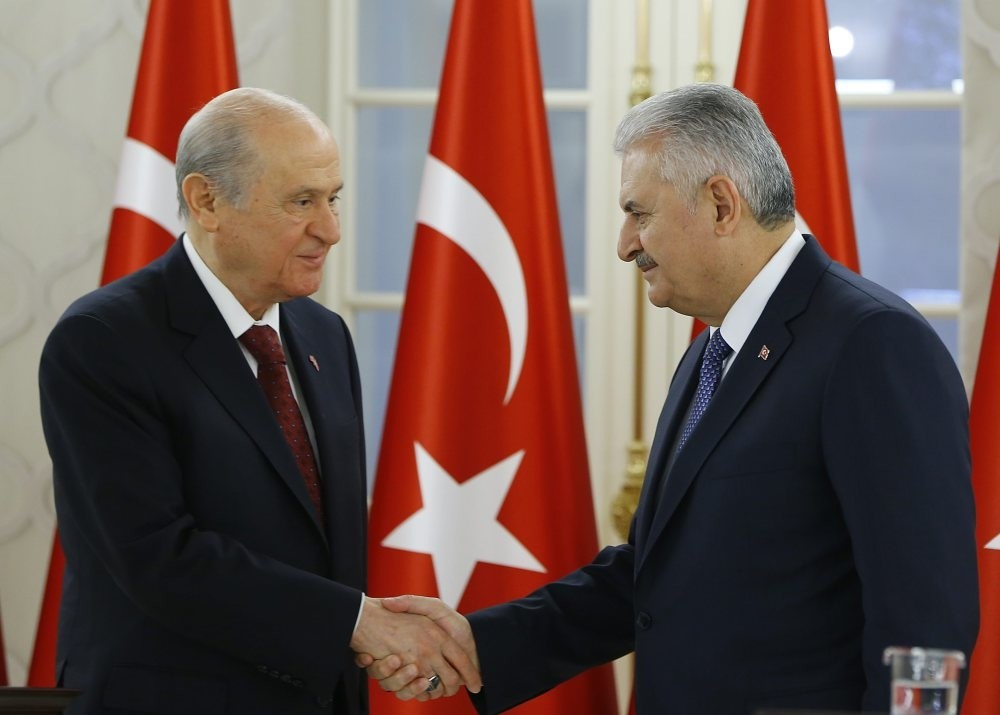MHP leader Bahu00e7eli (L) shaking hands with Prime Minister Yu0131ldu0131ru0131m following a bilateral meeting to discuss the constitutional changes on Dec. 2.