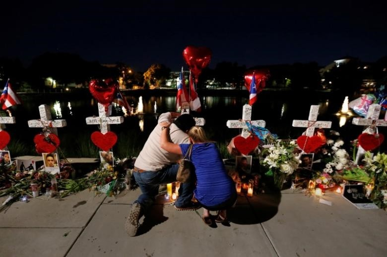 People cry in front of the makeshift memorial for the victims of the Pulse night club shootings, in Orlando, Florida, U.S., June 20, 2016. (Reuters Photo)