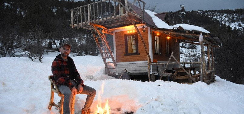 INTO THE WILD: NATURE LOVER BUILDS SELF-SUSTAINABLE CARAVAN