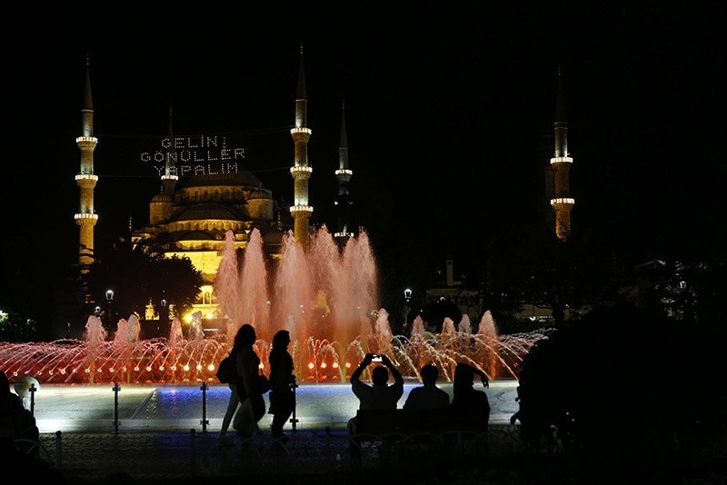 People walk past in front of the Sultanahmet Mosque (Bluemosque) on the first day of Ramadan, in Fatih Istanbul, Turkey, 06 June 2016. (EPA)