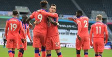 Chelsea go top with win at Newcastle