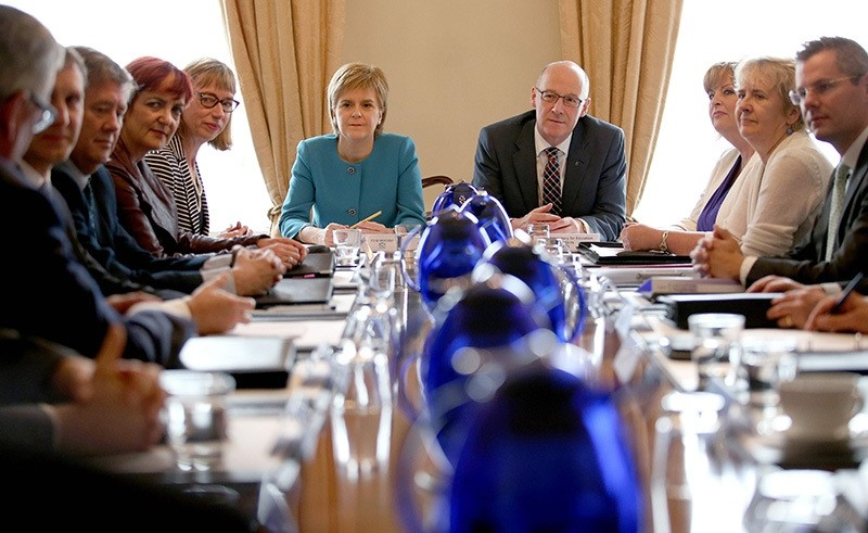 Scotland's First Minister and Leader of the Scottish National Party (SNP), Nicola Sturgeon (6L), chairs an emergency Cabinet meeting at Bute House in Edinburgh, Scotland, following the pro-Brexit result of the UK's EU referendum vote. (AFP Photo)