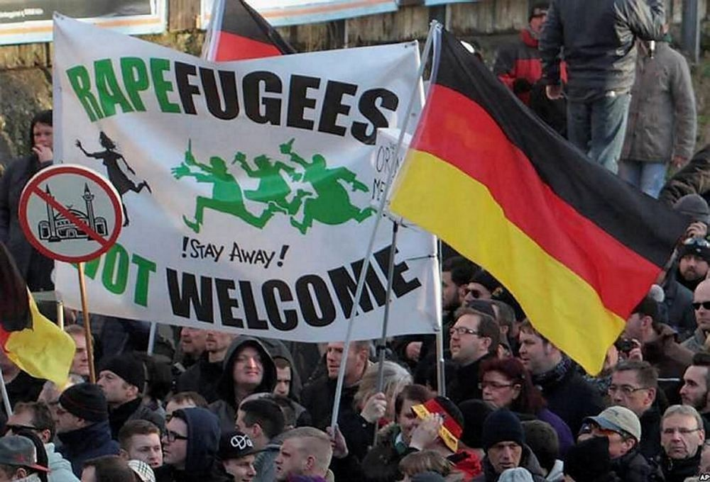 Supporters of far-right groups protesting against refugees and Islam in Germany.