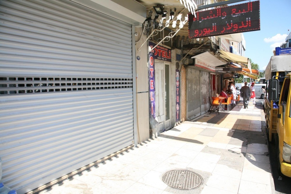 Basmane's migrant quarters is largely deserted now, forcing shops with Arabic signs to close down in the absence of clientele.
