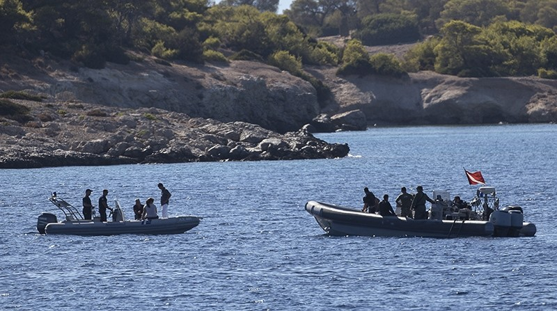 Greek authorities search an area between Aegina and the small deserted islet of Moni, southwest of Athens, Tuesday, Aug. 16, 2016 (AP Photo)