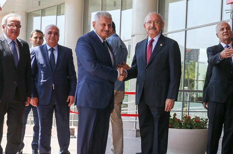 Prime Minister Binali Yu0131ldu0131ru0131m visited main opposition Republican People's Party (CHP) chairman Kemal Ku0131lu0131u00e7darou011flu at the party headquarters in Ankara. (AA Photo)