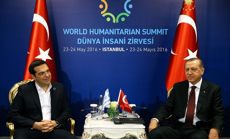 President Recep Tayyip Erdou011fan, right, and Greek Prime Minister Alexis Tsipras, sit prior to their meeting at the World Humanitarian Summit in Istanbul, Monday, May 23, 2016 (AP Photo)