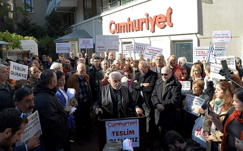 Protestors reading out statements in front of Cumhuriyet daily's building in u015eiu015fli, u0130stanbul (DHA Photo)