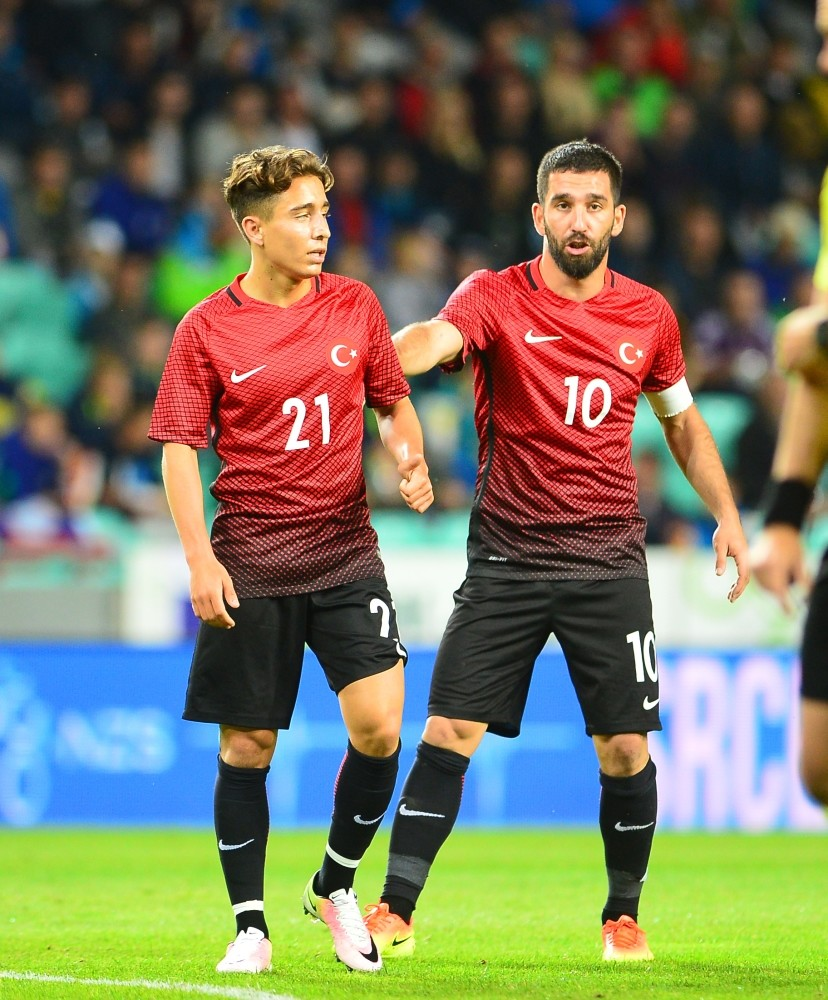 While youngster Emre Mor(L) shined for Turkey, Arda Turan on whom Turkish fans were largely pinning their hopes toiled at the Euros.