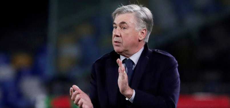 NAPOLI SACKS COACH ANCELOTTI DESPITE ADVANCING IN CHAMPIONS LEAGUE