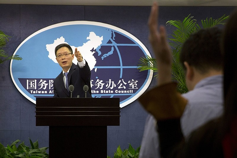 Taiwan Affairs Office spokesman An Fengshan signals for questions from a journalist at a routine press conference in Beijing, China on Wednesday, Dec. 14, 2016. (AP Photo)