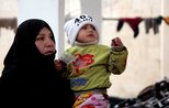 Syrian families take refuge in mosque from bombings
