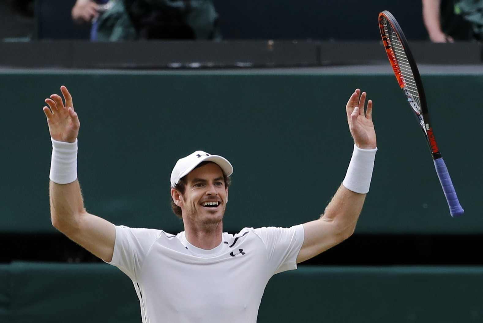 Andy Murray of Britain celebrates after beating Milos Raonic of Canada in the men's singles final on the fourteenth day of the Wimbledon Tennis Championships in London, Sunday, July 10, 2016. (AP Photo)