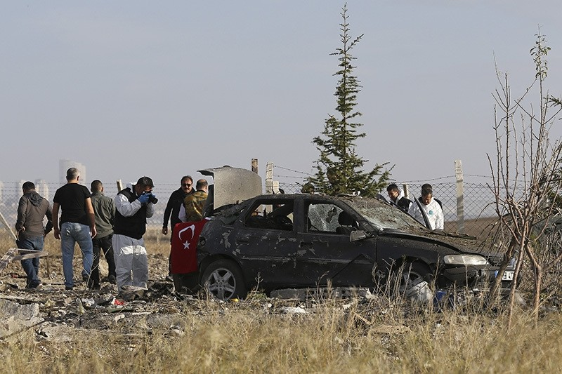 Police investigating the vehicle in which two terrorists blew themselves up outside a horse farm in Ankara's Haymana district on October 8, 2016 (AA Photo)