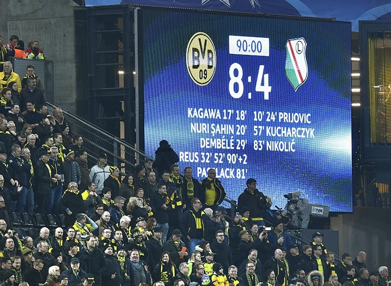 Spectators stand in front of the scoreboard during the Champions League Group F soccer match between Borussia Dortmund and Legia Warsaw in Dortmund, Germany, Nov. 22, 2016. (AP Photo)