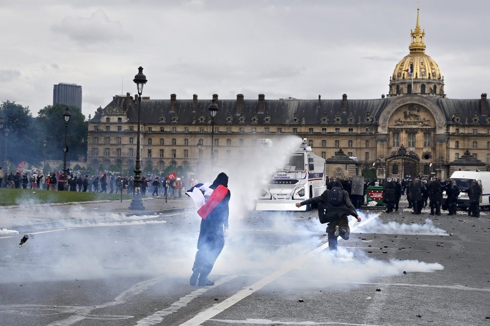 French riot police use water guns during clashes with protestors as part as a national demonstration and strike against the Labor Law reform in Paris.