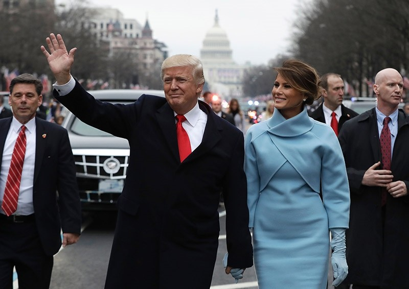 President Donald Trump waves as he walks with first lady Melania Trump during the inauguration parade on Pennsylvania Avenue in Washington on Jan. 20, 2107. (AFP Photo)