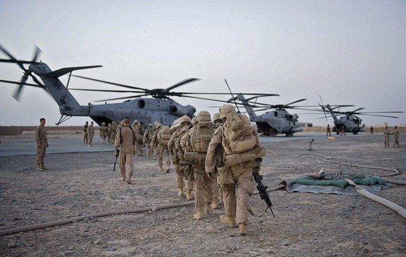 US Marines from the 2nd Battalion, 8th Marine Regiment of the 2nd Marine Expeditionary Brigade walk towards the helicopter as part of Operation Khanjar at Camp Dwyer in Helmand Province in Afghanistan on July 2, 2009. (AFP Photo)