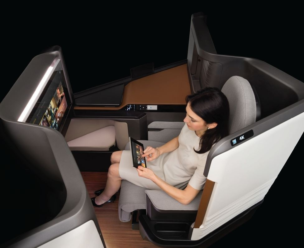 Panasonic's airplane seat equipped with luxury entertainment technology.