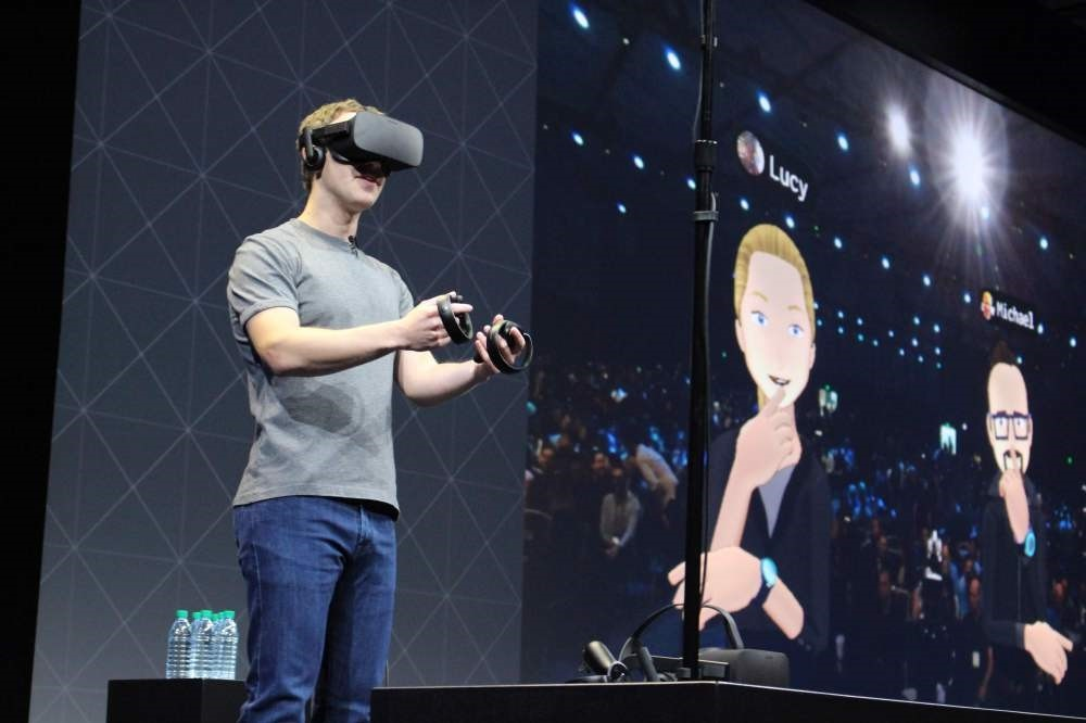 Facebook co-founder and chief executive, Mark Zuckerberg, speaks at an Oculus developers conference while wearing a virtual reality headset in San Jose, California.