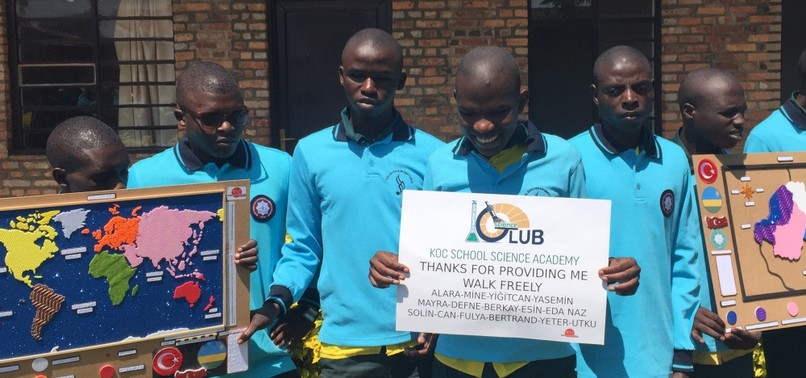 HIGH SCHOOLERS AID VISUALLY IMPAIRED AFRICAN STUDENTS