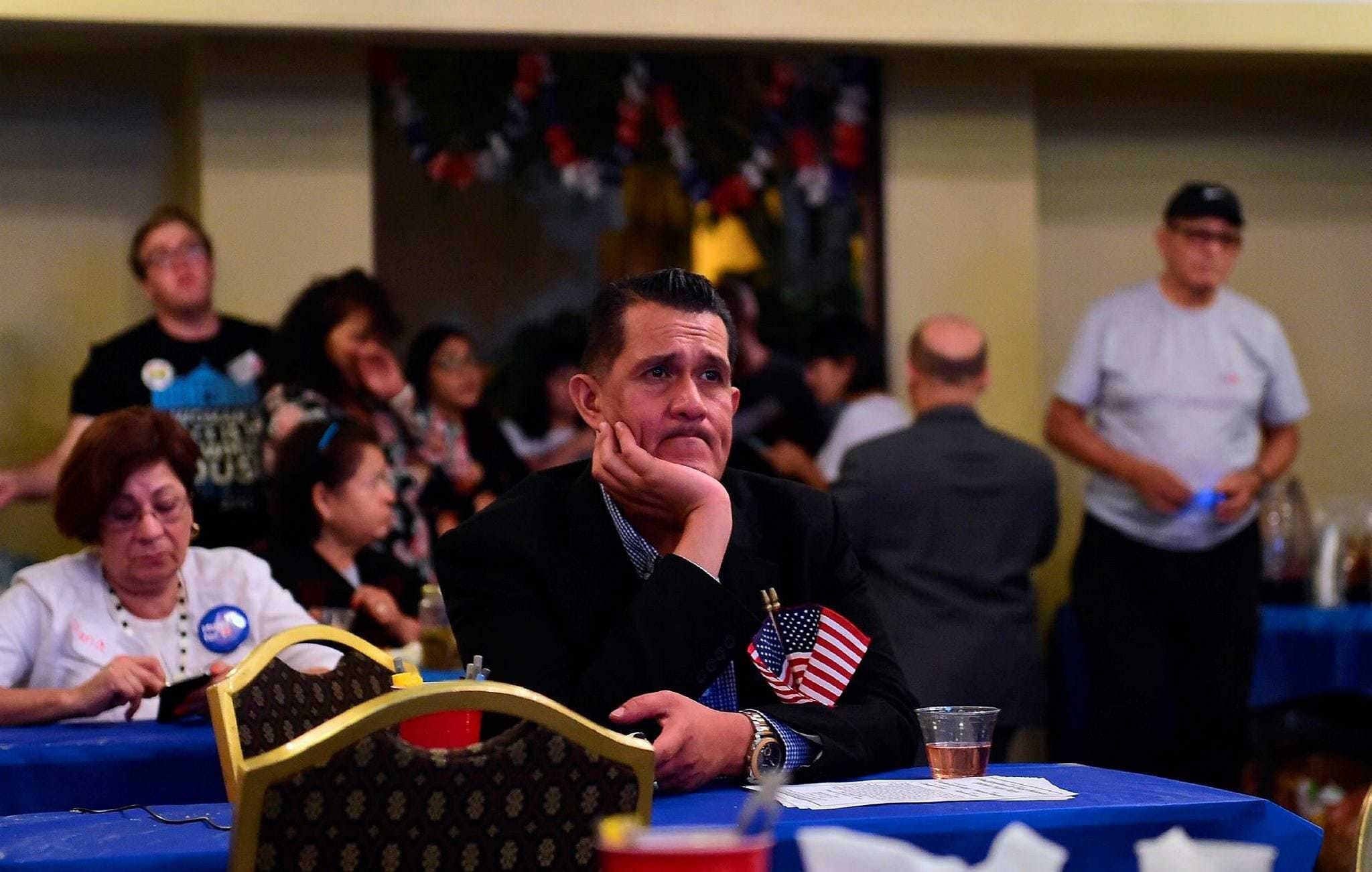 People watch the election results from the headquarters of U.S. Democratic presidential candidate Hillary Clinton in East Los Angeles, California, Nov. 8.