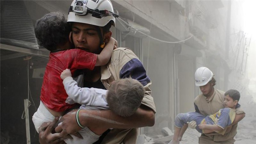 Two Syrian Civil Defense volunteers are saving three children after a bombing attack in Aleppo. The shelling in Aleppo has been hitting thousands of civilians since the beginning of the Civil War in Syria.