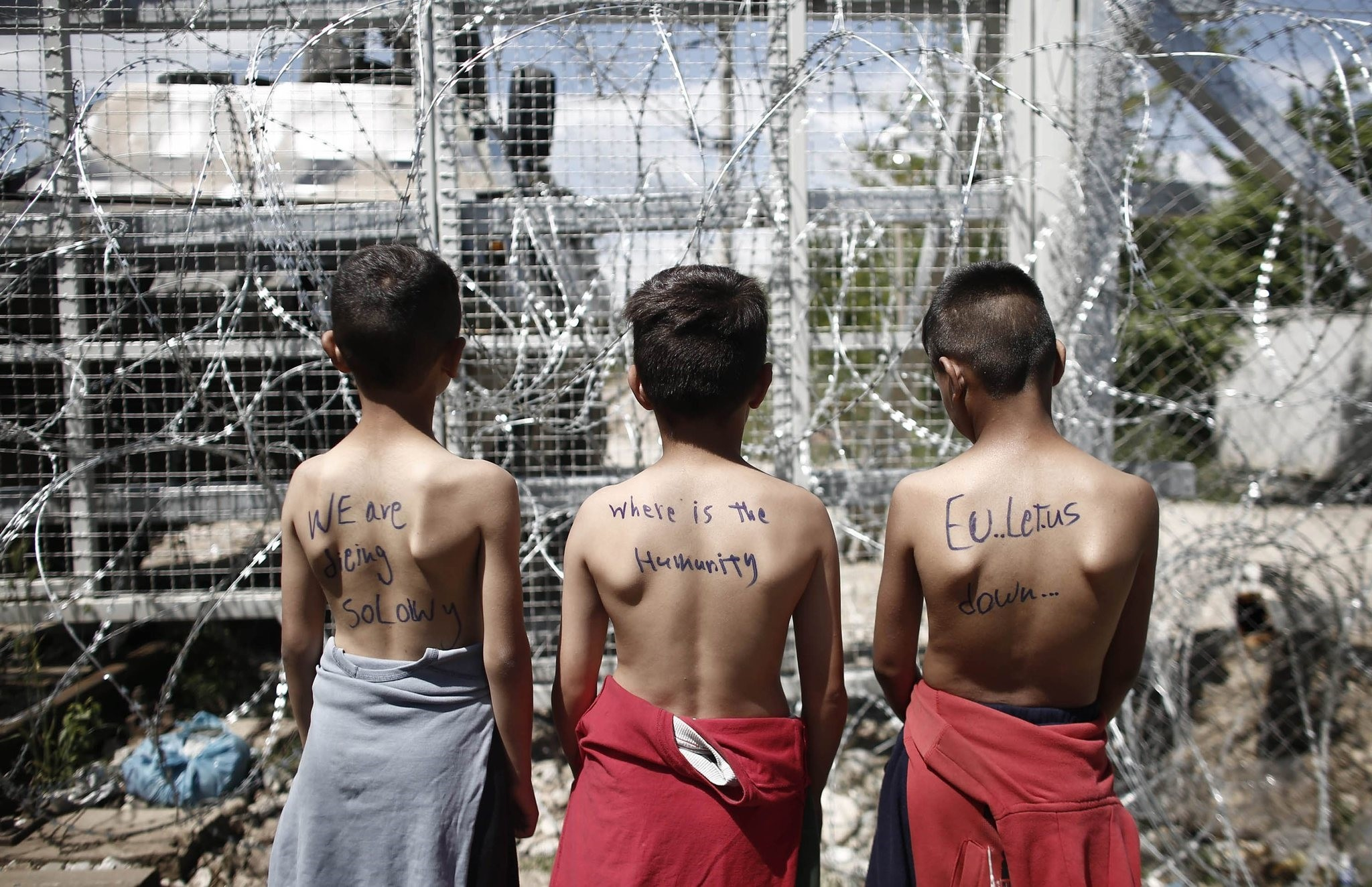 Refugee boys take part in a protest demanding the opening of the border between Greece and Former Yugoslav Republic of Macedonia (FYROM) at a refugee camp, near the village of Idomeni. (EPA Photo)