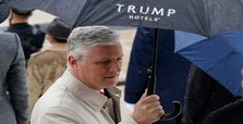 Trump's security adviser vows 'professional transition'