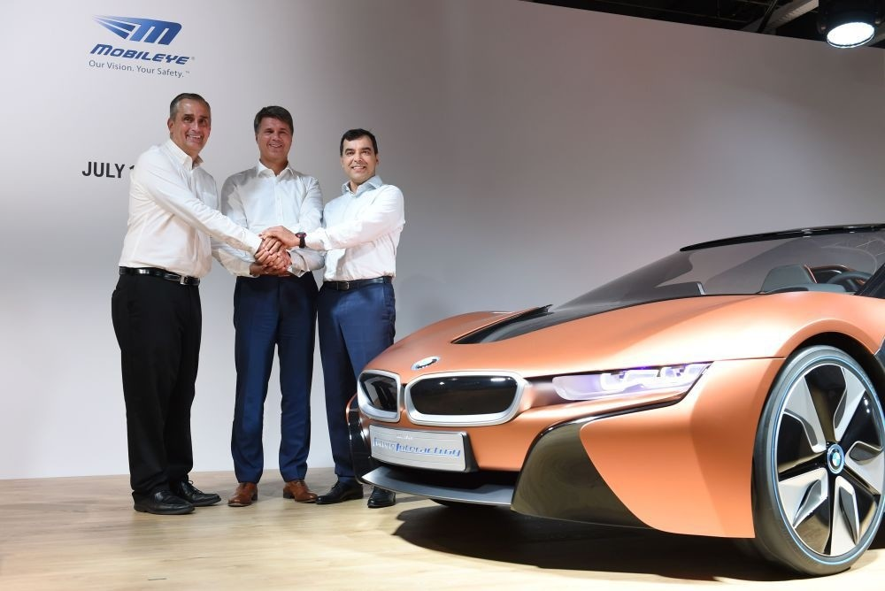 (L-R) Brian Krzanich, CEO of Intel, Harald Krueger, CEO of German car maker BMW and Amnon Shashua, co-founder, chairman and CTO Mobileye NV, pose after a press conference in Munich.