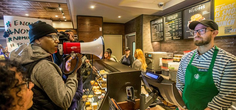 SCORES OF PROTESTERS AT STARBUCKS CHANT COMPANY IS ANTI-BLACK