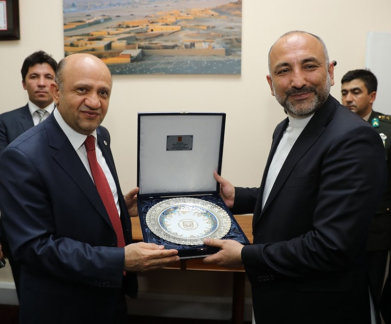 Turkish defense minister Fikri Iu015fu0131k (L), National Security Advisor to Ashraf Ghani the President of Afghanistan, Hanif Atmar (R) in Kabul (AA photo)