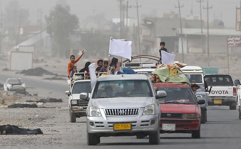 Civilians stuck between clashes in Kokjeli flee the region (AA Photo)