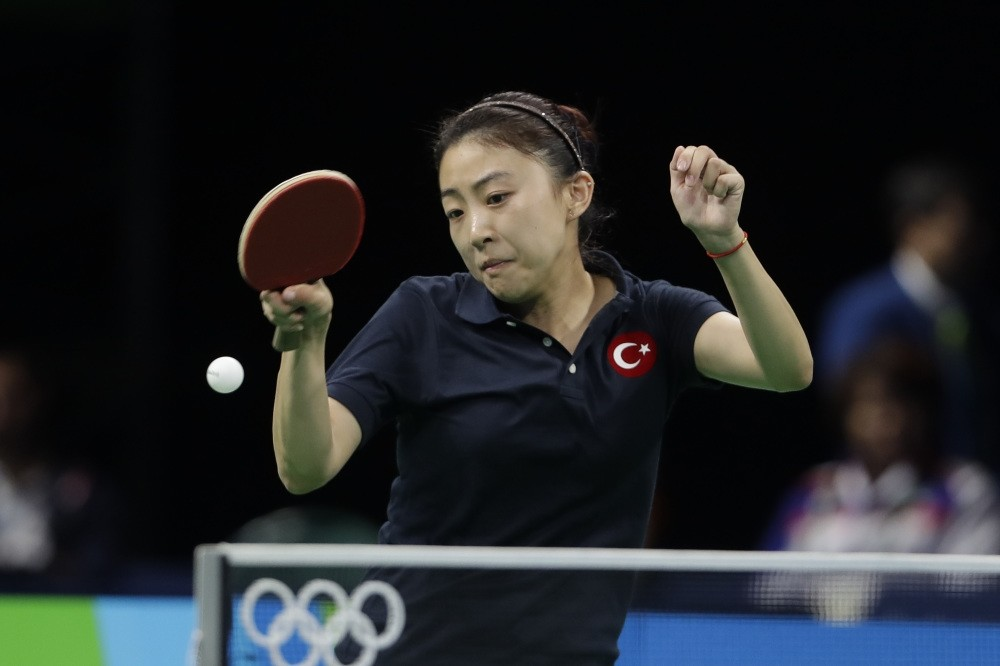 Chinese-born Turkish player Melek Hu plays against Chen Szu-Yu of Taiwan during their table tennis match at the 2016 Summer Olympics in Rio de Janeiro.