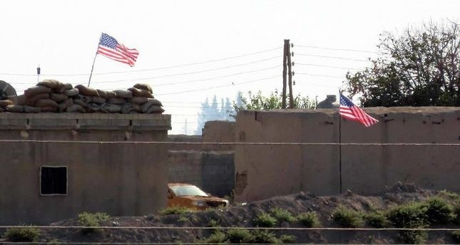 U.S. flags are displayed at a base of the terrorist PYD/PKK in the Mumbatih region of the Tal Abyad district in the Raqqa governorate, north Syria.